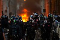 Roma  15 Ottobre 2011.Manifestazione contro la crisi e l'austerità.Scontri tra manifestanti e forze dell'ordine.I carabinieri in Via Matteo Boiardo all'angolo di Pzza San Giovanni fermati da una barricata data alle fiamme dai manifestanti.