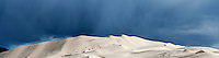 Winter rain storm clouds over Eureka dunes, Death Valley national park, California