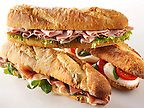 Bread baguettes filled with mozerella & tomatoes, ham & salad, Prcutto ham & rocket.