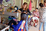 Woman Giving Haircut At Little Boy At Phsar Nath Market