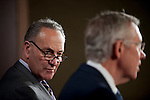 Senator CHUCK SCHUMER (D-NY) looks on as Senate Majority Leader Harry Reid speaks to the media on Capitol Hill on Wednesday. Reid said the Senate should pass a two-year $109 billion highway bill in the coming days that will provide a boost to the American economy as the highway construction season begins.