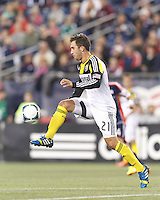 Columbus Crew defender Chad Barson (21) at midfield.  In a Major League Soccer (MLS) match, the New England Revolution (blue) defeated Columbus Crew (white), 3-2, at Gillette Stadium on October 19, 2013.