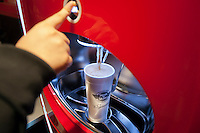 """Customer uses self-service drink machine at the new Steak 'n Shake Signature restaurant in New York on its grand opening day, Thursday, January 12, 2012. The popular midwest chain opened its first New York outpost with a new concept for the restaurant, a smaller footprint and counter-only service, hence their """"Signature"""" branding. Founded in 1934 the company has nearly 500 restaurants with this one in New York being next to the Ed Sullivan Theatre where the Late Show with David Letterman Show is taped. © Richard B. Levine)"""