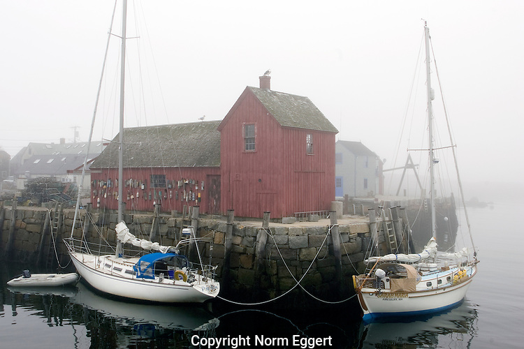 Two sailboats tied up to the dock at Motif#1 on a very foggy day.