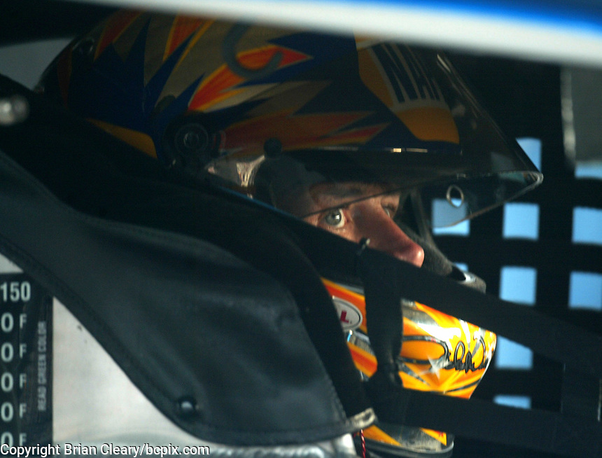 Michael Waltrip sits in his car during a practice session for the Pop Secret 400 NASCAR Winston Cup race at Rockingham, NC on Saturday, November 8, 2003. (Photo by Brian Cleary)