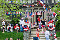 Crowd of spectators at  Loyalty day patriotic parade in small town USA.