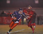 Lafayette High's Keeyon Tyson (36) sacks North Pontotoc quarterback Caleb Mills at William L. Buford Stadium in Oxford, Miss. on Thursday, October 27, 2011.. Lafayette High won 49-7.