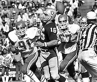 Oakland Raiders QB Jim Plunkett passing against the kansas City Chiefs, Ken Kremer, and Art Still rushing.<br />