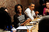 United States President Barack Obama and First Lady Michelle Obama have dinner with winners of a campaign contest, including Judy Glassman, far right, from Cambridge, MA, at Boundary Road, on Thursday, March 8, 2012, in Washington, DC.  .Credit: Leslie E. Kossoff / Pool via CNP