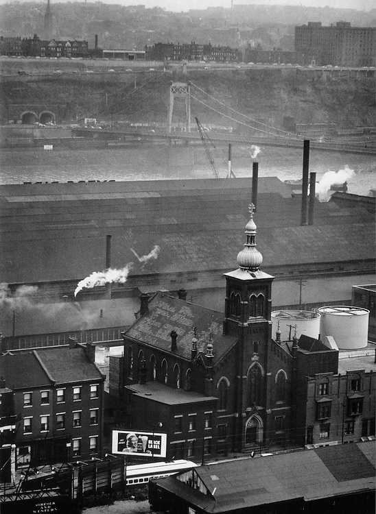 Second Street Saint John's Greek Catholic Church; A.M. Byers iron pipe manufacturer, and Monongahela River in background. Photograph by W. Eugene Smith.