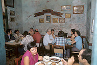 June, 1977. Havana, Cuba. Eighteen years after the Cuban Revolution the first U.S. tourists were permitted to visit Havana. La Bodeguita Del Medio, crowded with U.S. tourists, was the favorite bar of Ernest Hemingway.