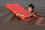 Cambodian boy playing on The Tonle Sap, a combined lake and river system of huge importance to Cambodia. The area is home to many ethnic Vietnamese and numerous Cham communities living in floating villages around the lake. The Tonle Sap is the largest freshwater lake in Southeast Asia and is an ecological hot spot that was designated as a UNESCO biosphere in 1997. The Tonle Sap is a branch of the mighty Mekong River.