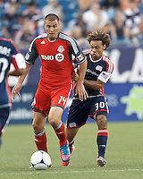 Toronto FC forward Danny Koevermans (14) shields ball from New England Revolution defender Kevin Alston (30). In a Major League Soccer (MLS) match, Toronto FC defeated New England Revolution, 1-0, at Gillette Stadium on July 14, 2012.