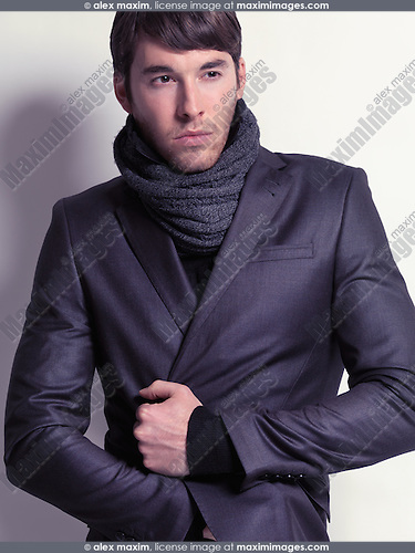 Stock photo: Fashion portrait of a young man wearing a black blazer