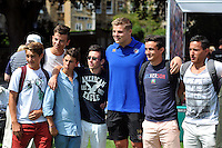 Tom Ellis of Bath Rugby poses for a photo with supporters. Bath Rugby Family Festival of Rugby, on August 8, 2015 at the Recreation Ground in Bath, England. Photo by: Patrick Khachfe / Onside Images