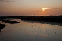 Stiffkey, Norfolk, England, 07/08/2009..Stiffkey salt marshes at dusk.