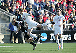 Maryland's Robbie Rogers (top) and New Mexico's Brandon Moss (below) fall to the ground while challenging for the ball. The University of Maryland Terrapins defeated the University of New Mexico Lobos 1-0 in the Men's College Cup Championship game at SAS Stadium in Cary, NC, Friday, December 11, 2005.