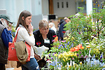 A visitor buys plants at an RHS Secret Garden Sunday.