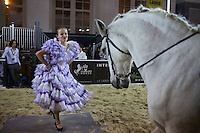 Moscow, Russia, 24/10/2009..A Spanish dancer performs with thoroughbred horses at the Millionaire Fair in Moscow. The event has become an annual fixture, attracting thousands of would-be and existing Russian millionaires to view and purchase a wide range of luxury goods. This year however the fair was much smaller, an indication of how the formerly booming Russian economy has been hit by the world financial crisis.