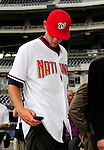 21 August 2009: Washington Nationals' first round draft pitcher Stephen Strasburg checks a message on his phone after being formally introduced to the media during a televised event at Nationals Park in Washington, DC. The Nationals agreed to terms with Strasburg, the 2009 number one overall pick in this years' MLB Draft, with fewer than two minutes before the signing deadline. Mandatory Credit: Ed Wolfstein Photo