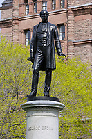 Toronto (ON) CANADA,  April , 2008-<br /> Statue of George Brown  in Queens Park.<br /> <br /> urban park in the Downtown area of Toronto. Opened in 1860 by Edward, Prince of Wales, it was named in honour of Queen Victoria. The park is the site of the Ontario Legislature, which houses the Legislative Assembly of Ontario, and so the phrase Queen's Park is also frequently used to refer to the Government of Ontario.
