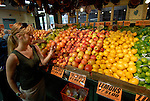 Reading Terminal Market, woman buying produce, mod rel..Philadelphia, Pennsylvania, PA USA.  Photo copyright Lee Foster, 510-549-2202, lee@fostertravel.com, www.fostertravel.com.  Photo 228-30532.