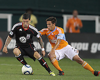 Santino Quaranta #25 of D.C. United moves the ball away from Danny Cruz #5 of the Houston Dynamo during an MLS match at RFK Stadium in Washington D.C. on September  25 2010. Houston won 3-1.