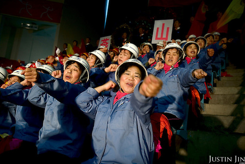 Cheerleaders from a worker's group compete in a cheerleading competition in Beijing organised for the Olympics in Beijing, which is getting ready to host the 2008 Summer Games.