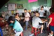 Customers seen at local kopitiam (traditional Chinese breakfast and coffee shop) in capital Georgetown of Penang in Malaysia. Photo: Sanjit Das/Panos