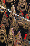 "Spiral Incense Coils, Thien Hau Pagoda -  An incense coil is made entirely of incense and called this because they are shaped into a spiral instead of a straight stick shape and can burn for many hours. There are many forms of  incense and its use and formulation is strongly tied to traditional Chinese medicine and are still referred today as ""fragrant medicines"". The use of incense has long been as much for healthy well being as religious purposes."