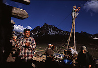Spending the warm months in the mountains keeps tradition alive--but why rough it beyond what's neccessary?  In Avusor, Turkey, Adem Kesimal (above at left) and Sadik Karagoz (on pole) hooked up a small generator, powered by snowmelt, to give each home enough electricity for a few lightbulbs and a radio.