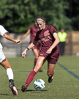 Virginia Tech forward Nicolette Young (28) avoids a defender.Virginia Tech (maroon) defeated Boston College (white), 1-0, at Newton Soccer Field, on September 22, 2013.