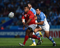 Elvis Taione of Tonga passes the ball. Rugby World Cup Pool C match between Argentina and Tonga on October 4, 2015 at Leicester City Stadium in Leicester, England. Photo by: Patrick Khachfe / Onside Images
