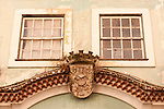 Two windows with the seal of Coimbra below in Coimbra, Portugal.
