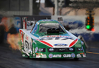 Jan 23, 2010; Chandler, AZ, USA; NHRA funny car driver Ashley Force Hood launches off the starting line during testing at the National Time Trials at Firebird International Raceway. Mandatory Credit: Mark J. Rebilas-