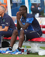 Mario Balotelli of Italy shows a look of dejection on the bench after Claudio Marchisio is sent off