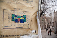 Plans for the redevelopment of the Old City of Kashgar, Xinjiang, China.  The plans will radically change the neighborhood, replacing the old-style alleyways and houses with contemporary Chinese apartment block style residences.