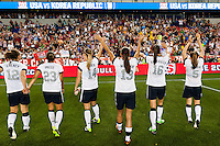 United States (USA) players salute the fans after the match. The women's national team of the United States defeated the Korea Republic 5-0 during an international friendly at Red Bull Arena in Harrison, NJ, on June 20, 2013.
