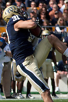 Pitt defensive back Dom DeCicco makes an interception. The Pittsburgh Panthers defeated the Rutgers Scarlet Knights 41-21 on October 23, 2010 at Heinz Field, Pittsburgh, Pennsylvania....