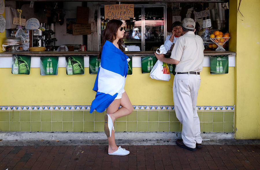 MIAMI - MARCH 9, 2014: Woman wearing a flag during the the 37th Calle Ocho festival, an annual event that takes place over Eight Street in Little Havana featuring plenty of music, food, and  it is the biggest party in town that celebrates hispanic heritage.