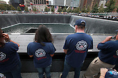 On the 10th anniversary of the September 11th attacks, family members of firefighters who died at opening day of the September 11th Memorial at the World Trade Center site in New York, New York on September 11, 2011..Credit: Jefferson Siegel / Pool via CNP