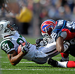 30 September 2007: Buffalo Bills cornerback Kiwaukee Thomas tackles New York Jets wide receiver Laveranues Coles at Ralph Wilson Stadium in Orchard Park, NY. The Bills defeated the Jets 17-14 for their first win of the 2007 season...Mandatory Photo Credit: Ed Wolfstein Photo for UPI