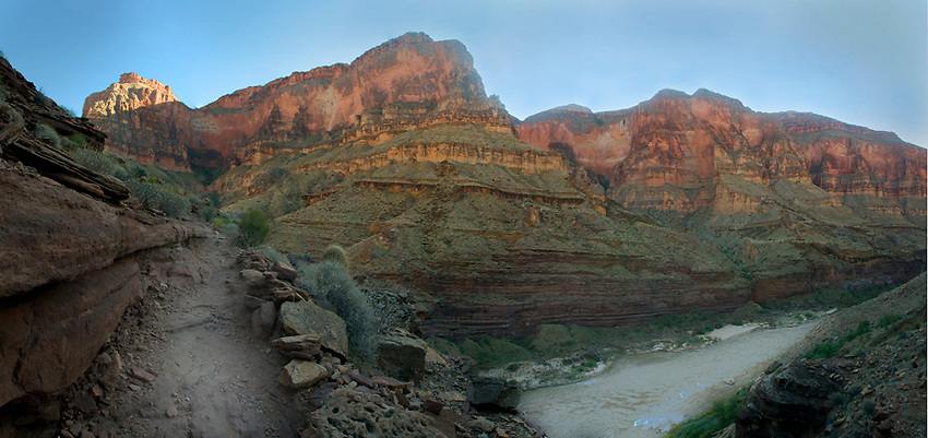 A panoramic image of the Colorado River and the Deer Creek Trail, with sweeping cliffs.