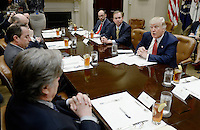 United States President Donald Trump discusses the Federal budget in the Roosevelt Room of the White House on February 22, 2017 in Washington, DC. OMB director Mick Mulvaney sits to the President's right.<br /> Credit: Olivier Douliery / Pool via CNP /MediaPunch