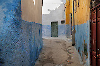 A narrow street with colourful painted walls in the medina or old town of Tetouan, on the slopes of Jbel Dersa in the Rif Mountains of Northern Morocco. Tetouan was of particular importance in the Islamic period from the 8th century, when it served as the main point of contact between Morocco and Andalusia. After the Reconquest, the town was rebuilt by Andalusian refugees who had been expelled by the Spanish. The medina of Tetouan dates to the 16th century and was declared a UNESCO World Heritage Site in 1997. Picture by Manuel Cohen