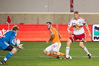 New York Red Bulls goalkeeper Ryan Meara (18) saves a shot by Will Bruin (12) of the Houston Dynamo. The New York Red Bulls defeated the Houston Dynamo 1-0 during a Major League Soccer (MLS) match at Red Bull Arena in Harrison, NJ, on May 09, 2012.