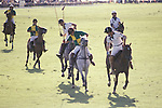 Prince Charles playing Polo at Windsor Great Park.  The English Season published by Pavilon Books 1987