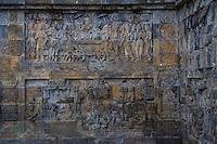 Borobudur, Java, Indonesia.  Bas-relief Stone Carving Representing Queen Maya riding a horse-drawn carriage retreating to Lumbini to give birth to Prince Siddhartha Gautama, the Buddha.