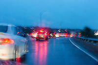 Rainy evening rush hour traffic congestion Mopac bridge in Austin, Texas.