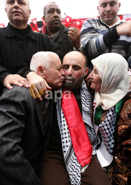 Former Palestinian prisoner Jihad Abedi is greeted following his release from an Israeli jail after serving 25 years, in Jerusalem on January 20, 2013. Photo by Mahfouz Abu Turk